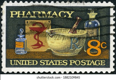 MOSCOW, RUSSIA - OCTOBER 10, 2020: A stamp printed in USA shows Mortar and Pestle, Bowl of Hygeia, 19th Century Medicine Bottles, Pharmacy Issue, 1972
