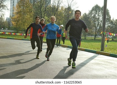 MOSCOW, RUSSIA - October 11, 2014: Students run a sprint. Physical training in a municipal school in Moscow.