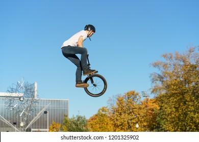 Moscow / Russia - October 11 2018: Biker doing stunt in the sky