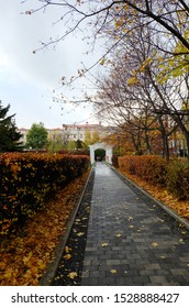 Moscow / Russia - October, 11, 2019: View of the garden to them. Bauman in the fall, paths, pavilions, decorative planting.