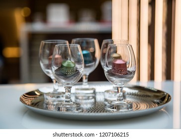 MOSCOW, RUSSIA - OCTOBER 13, 2018: Limited Collection Nespresso Master Origin Coffee Capsules in Glasses with Coffee in Nespresso Store in Moscow, Russia.