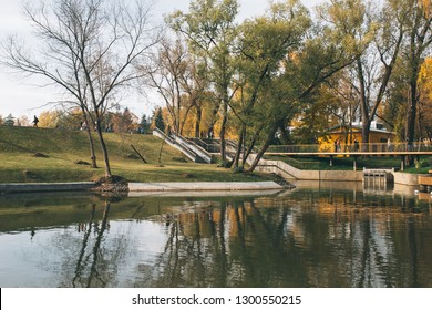 Moscow, Russia - October 14, 2018: Ponds near Botanical garden with walking people