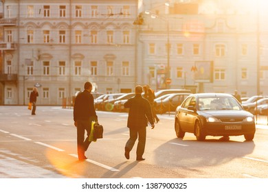 MOSCOW, RUSSIA - October 15, 2009. People cross the road in forbidden place. Pedestrians do not use an underground pedestrian crossing. Early morning at Vozdvizhenka Street.