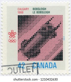 MOSCOW, RUSSIA - OCTOBER 15, 2016: A stamp printed in Canada shows Bobsledding, bobsleigh,1988 Winter Olympics, Calgary, Alberta, 1987
