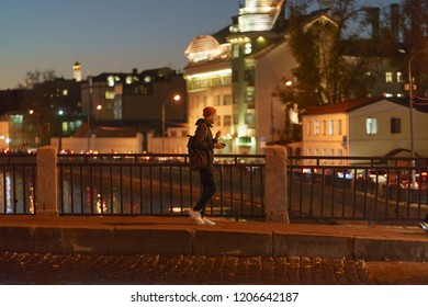 Moscow / Russia - October 16 2018: Lifestyle of Moscow citizens. Man at the city street at night time