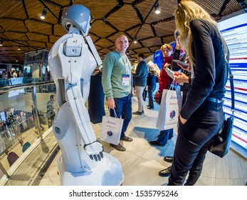 MOSCOW, RUSSIA - OCTOBER 16, 2019: Participants of the SolidWorks Summit Russia conference communicate with a robot KIKI designed by SolidWorks CAD system in Moscow, Russia on October 16, 2019.