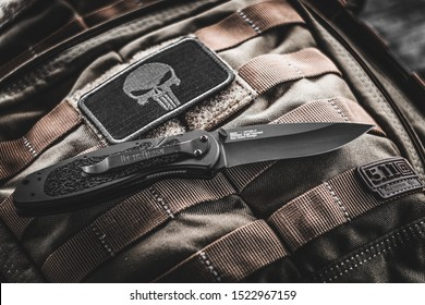 MOSCOW, RUSSIA - OCTOBER 17, 2019: Tactical photosession Kershaw Blur knife at the shooting range with tactical backpack 5.11 Rush 12.