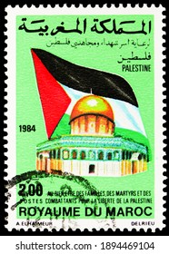 MOSCOW, RUSSIA - OCTOBER 17, 2020: Postage stamp printed in Morocco shows Arar revolt flag, Palestinian Solidarity serie, circa 1984