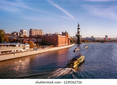 MOSCOW, RUSSIA - OCTOBER 18, 2018: Moscow skyline at sunset on the Moskva River : Krasny Oktyabr confectionary  and Peter The Great statue in the background