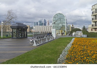 MOSCOW, RUSSIA - OCTOBER 2, 2016:  Bicycle parking at the entrance to the pedestrian bridge across the Moscow River. Cloudy day in mid-October. Moscow, Russia.