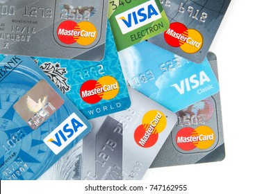 Moscow, Russia - October 20, 2017: Visa and MasterCard credit card on white background. Mastercard and Visa are a biggest credit card companies in the world.