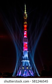 "MOSCOW, RUSSIA - OCTOBER, 2014: International Festival ""Circle of Light"". Laser video mapping show on Ostankino TV tower in Moscow, Russia. 3D projection mapping on building and firework show"