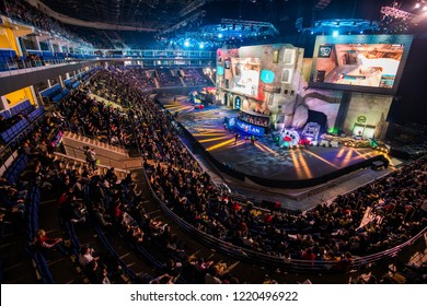 MOSCOW, RUSSIA - OCTOBER 2018: Counter Strike: Global Offensive esports event. Main stage venue and tribunes full of visitors and fans. View from the top.