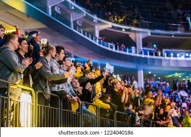 MOSCOW, RUSSIA - OCTOBER 2018: Counter Strike: Global Offensive esports event. Fans on a tribunes with posters supporting their favorite team.