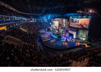MOSCOW, RUSSIA - OCTOBER 2018: Counter Strike: Global Offensive esports event. Colorful main stage venue with lot of illumination and big screens with a game moments on it. Players booths