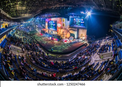 MOSCOW, RUSSIA - OCTOBER 2018: Counter Strike: Global Offensive esports event. Colorful main stage venue with lot of illumination and tribunes full of visitors and fans. Overlooking
