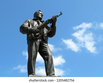 Moscow, Russia - October 2018: Monument to the weapons developer Mikhail Kalashnikov on blue sky background. The creator of the Kalashnikov assault rifle AK-47, soviet and russian designer of small arms