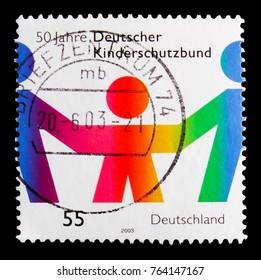 MOSCOW, RUSSIA - OCTOBER 21, 2017: A stamp printed in German Federal Republic shows Children protection, 50th anniversary serie, circa 2003