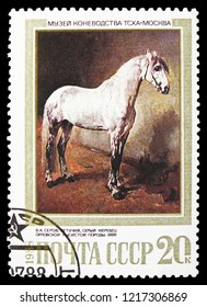 MOSCOW, RUSSIA - OCTOBER 21, 2018: A stamp printed in USSR (Russia) shows Letuchy, Grey Stallion of Orlov Trotter Breed (V. Serov, 1886), Horses in Paintings serie, circa 1988