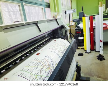 MOSCOW, RUSSIA - OCTOBER 21, 2018: Professional wide format printing machine prints map of moscow metro