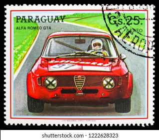 MOSCOW, RUSSIA - OCTOBER 21, 2018: A stamp printed in Paraguay shows Alfa Romeo GTA, Touring car serie, circa 1987
