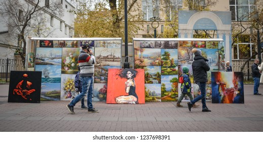 Moscow, Russia - October 21st 2018 : Trade paintings on the Arbat street, Arbat Street once served as a main Moscow artery and is one of the oldest original streets in Moscow