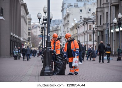Moscow, Russia - October 21st 2018 : Garbage collectors work during evening hours, Arbat street, Moscow.