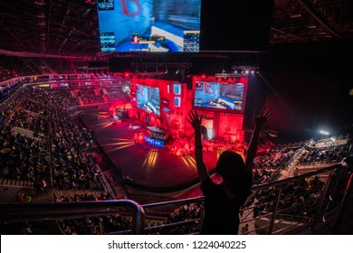 MOSCOW, RUSSIA - OCTOBER 27 2018: EPICENTER Counter Strike: Global Offensive esports event. Happy girl fan on a tribune at arena cheering for her favorite team. Hands raised