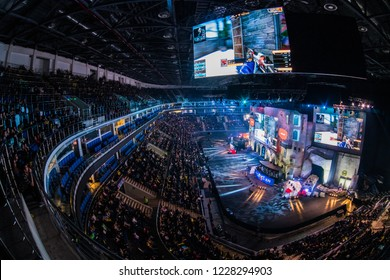 MOSCOW, RUSSIA - OCTOBER 27 2018: EPICENTER Counter Strike: Global Offensive esports event. Colorful main stage venue with lot of illumination and big screens with a game moments on it. Players booths