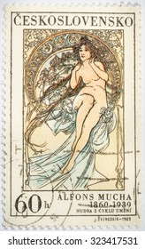 """Moscow, Russia - October 3, 2015: A stamp printed in Czechoslovakia shows women allegory """"Painting"""" by Alfons Mucha, circa 1969"""