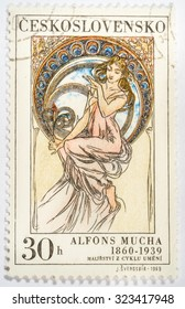 """Moscow, Russia - October 3, 2015: A stamp printed in Czechoslovakia, shows women allegory """"Music"""" paintings by Alfons Mucha, circa 1969"""