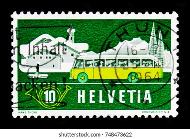 MOSCOW, RUSSIA - OCTOBER 3, 2017: A stamp printed in Switzerland shows Post in summer landscape (Graubunden), Post in the Alps serie, circa 1953