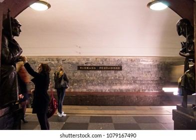 MOSCOW, RUSSIA - OCTOBER 5, 2017: Passengers touching the statue for blessing at the Ploshchad Revolyutsii (Revolution Square) Metro Station at Moscow, Russia