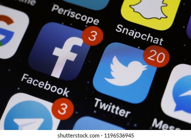 Moscow, Russia - October, 6 2018 The logos of the Facebook and Twitter applications are displayed on the screen of an Apple iPhone
