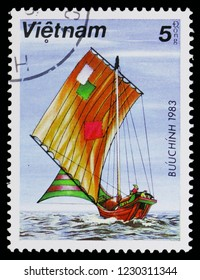 MOSCOW, RUSSIA - OCTOBER 6, 2018: A stamp printed in Vietnam shows Sailing boat with patched sails, Sampans serie, circa 1983