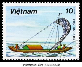 MOSCOW, RUSSIA - OCTOBER 6, 2018: A stamp printed in Vietnam shows Fishing Sailing Sampan, Sampans serie, circa 1983