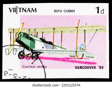 """MOSCOW, RUSSIA - OCTOBER 6, 2018: A stamp printed in Vietnam shows Aircraft Curtiss JN-4 Jenny, """"EXPO'86"""" World fair Vancouver (Ancient aircraft) serie, circa 1986"""