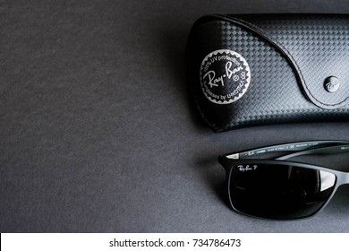 Moscow, Russia - October 8, 2017: The Ray-Ban Caravan with gold frame and classic G-15 Lens. Ray-Ban is a brand of sunglasses. Close up on a black background. Top view, flat lay. copy space