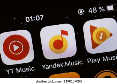 Moscow, Russia - October, 8 2018 The logos of the Youtube music, Yandex music and Google music applications are displayed on the screen of an Apple iPhone