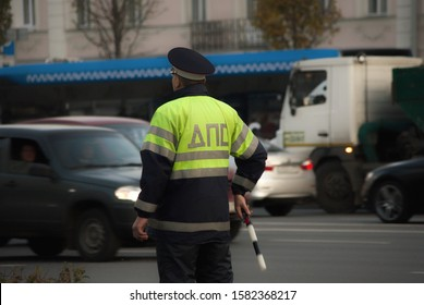MOSCOW / RUSSIA - OKTOBER 29, 2019: Traffic police inspector stands by the road