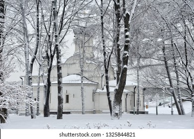 MOSCOW, RUSSIA -  The old 16th century Church of Conception of St. Anna behind trees covered snow on the grounds of Zaryadye Park after heavy snowfall.