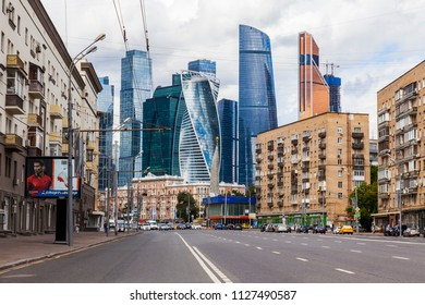 Moscow, Russia, on July 3, 2018. Urban view. Cars go on Dorogomilovskaya Street. Skyscrapers Moscow City are in the distance visible
