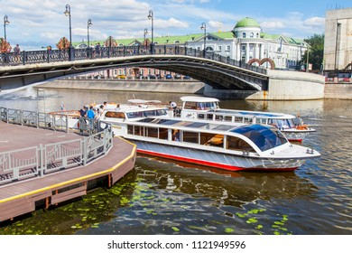 Moscow, Russia, on June 25, 2018. View of the river Moscow. Kadashyovskaya Embankment in a historical part of the city and Luzhkov Bridge. The walking ships are moored near the bridge