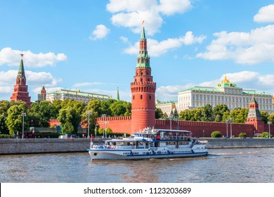 Moscow, Russia, on June 25, 2018. View of the river Moscow. Kremlevskaya Embankment and towers of the Moscow Kremlin. The walking ship floats down the river