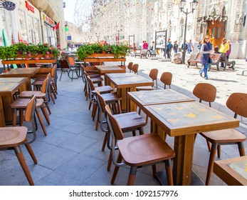 MOSCOW, RUSSIA, on MAY 10, 2018. Little tables of street cafe expect visitors on the sidewalk of Nikolskaya Street