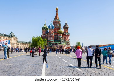 MOSCOW, RUSSIA, on MAY 10, 2018. People walk on Red Square and admire St. Basil's Cathedral (Pokrovsky Cathedral) which is one of city symbols