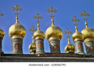 MOSCOW, RUSSIA - Onion-shaped Domes with crosses of Verkhospassky Cathedral - Beautiful gilded cupolas of Terem Palace in Moscow Kremlin.