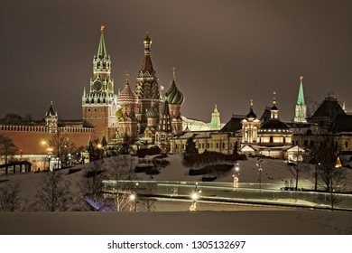 MOSCOW, RUSSIA - Postcard view of illuminated Moscow Kremlin's Tsarskaya (Tsar's) and Spasskaya (Savior) towers, St. Basil's Cathedral and Church of St. Barbara from Big Amphitheatre of Zaryadye Park.