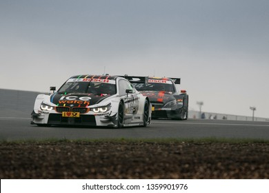 Moscow, Russia, Moscow Raceway - AUG 8, 2017: DTM 2017 Moscow stage BMW M4 DTM overtake Mercedes Benz AMG
