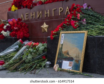 MOSCOW, RUSSIA, RED SQUARE, APRIL 4, 2017: People brought flowers and candles to the stone Leningrad in memory of those killed after the terrorist attack in St. Petersburg on April 3, 2017